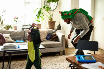 Father and son dressed as dinosaurs